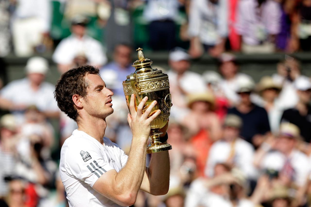 LONDON, ENGLAND - JULY 07:  Andy Murray of Great Britain poses with the Gentlemen's Singles Trophy following his victory in the Gentlemen's Singles Final match against Novak Djokovic of Serbia on day thirteen of the Wimbledon Lawn Tennis Championships at the All England Lawn Tennis and Croquet Club on July 7, 2013 in London, England.  (Photo by Pool/Getty Images)