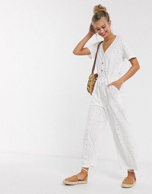 """<p><strong>ASOS Design</strong></p><p>us.asos.com</p><p><strong>$60.00</strong></p><p><a href=""""https://go.redirectingat.com?id=74968X1596630&url=https%3A%2F%2Fwww.asos.com%2Fus%2Fasos-design%2Fasos-design-button-front-tie-waist-jumpsuit-in-broderie-in-white%2Fprd%2F14118434&sref=https%3A%2F%2Fwww.goodhousekeeping.com%2Fholidays%2Fg32302046%2Ffourth-of-july-outfit-ideas%2F"""" rel=""""nofollow noopener"""" target=""""_blank"""" data-ylk=""""slk:Shop Now"""" class=""""link rapid-noclick-resp"""">Shop Now</a></p><p>With this white jumpsuit, you'll look cute and still be able to play all the yard games at your 4th of July BBQ. Pair it with <a href=""""https://go.redirectingat.com?id=74968X1596630&url=https%3A%2F%2Fwww.zappos.com%2Fp%2Fmia-lunna-red%2Fproduct%2F9254403%2Fcolor%2F585&sref=https%3A%2F%2Fwww.goodhousekeeping.com%2Fholidays%2Fg32302046%2Ffourth-of-july-outfit-ideas%2F"""" rel=""""nofollow noopener"""" target=""""_blank"""" data-ylk=""""slk:red sandals"""" class=""""link rapid-noclick-resp"""">red sandals</a> and these <a href=""""https://go.redirectingat.com?id=74968X1596630&url=https%3A%2F%2Fwww.etsy.com%2Flisting%2F280145910%2Famerican-flag-earrings-usa-flag-dangle&sref=https%3A%2F%2Fwww.goodhousekeeping.com%2Fholidays%2Fg32302046%2Ffourth-of-july-outfit-ideas%2F"""" rel=""""nofollow noopener"""" target=""""_blank"""" data-ylk=""""slk:flag earrings"""" class=""""link rapid-noclick-resp"""">flag earrings</a> to add a festive edge. </p>"""