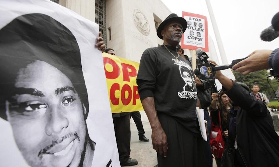 Cephus Johnson, known as Uncle Bobby X, stands on court steps in Los Angeles protesting against the release of Johannes Mehserle in 2011.