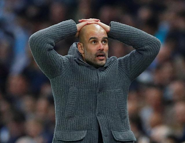 Pep Guardiola looks on in disbelief after VAR rules out a last-minute Raheem Sterling goal
