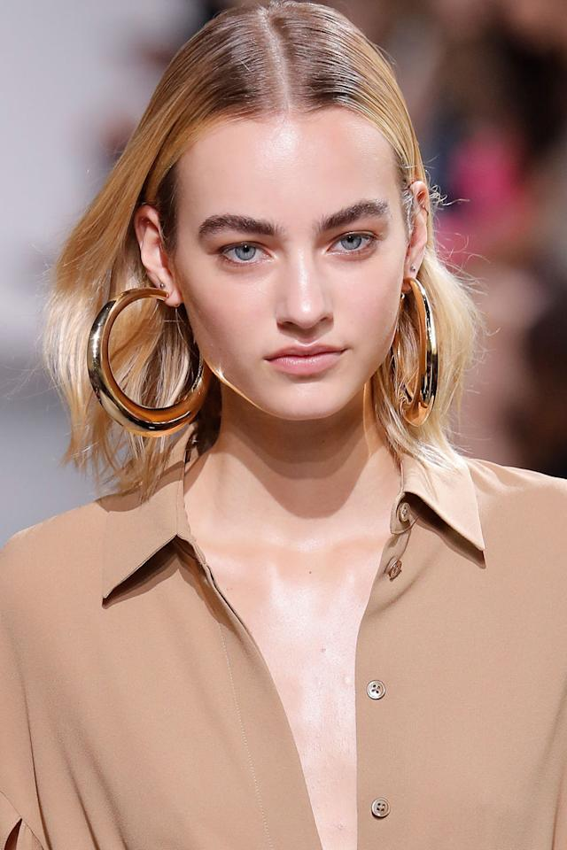 <p>Easy, effortless, undone—there's no other way to describe the beauty seen at Michael Kors this season. Hair was slicked back at the roots and tucked behind the ears. The makeup was all about glowing skin and touches of eyeliner. </p>