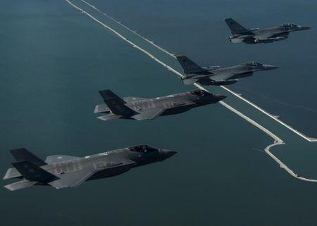 U.S. Air Force F-16 Fighting Falcon and F-35 Lightning II aircraft participate in a training mission near Kunsan Air Base