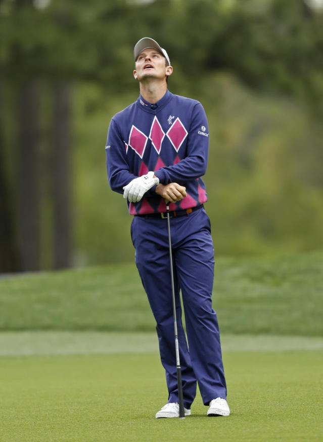 Justin Rose, of England, reacts after his approach shot on the 10th hole during the second round of the Wells Fargo Championship golf tournament in Charlotte, N.C., Friday, May 2, 2014. (AP Photo/Nell Redmond)