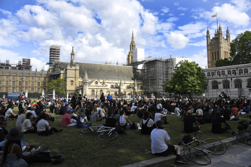 People gather for a protest, organised by Black Lives Matter, at the Parliament Square in central London, Sunday, June 21, 2020, in the wake of the killing of George Floyd by police officers in Minneapolis, USA last month that has led to anti-racism protests in many countries calling for an end to racial injustice. Anti-racism demonstrators are holding a fourth weekend of protests across the U.K.(AP Photo/Alberto Pezzali)