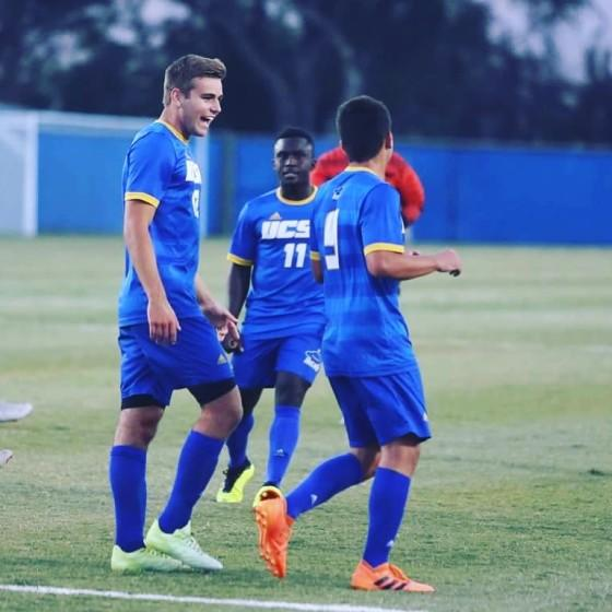 UCSB soccer's Carson Vom Steeg with teammates during a game.