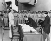 FILE PHOTO: Japan's Foreign Minister Mamoru Shigemitsu signs the Instrument of Surrender onboard the U.S. Navy battleship USS Missouri in Tokyo Bay