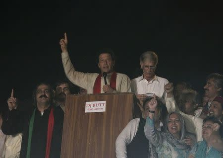 Khan, cricketer-turned-opposition politician and chairman of the Pakistan Tehreek-e-Insaf political party, gestures to his supporters during the Freedom March in Islamabad