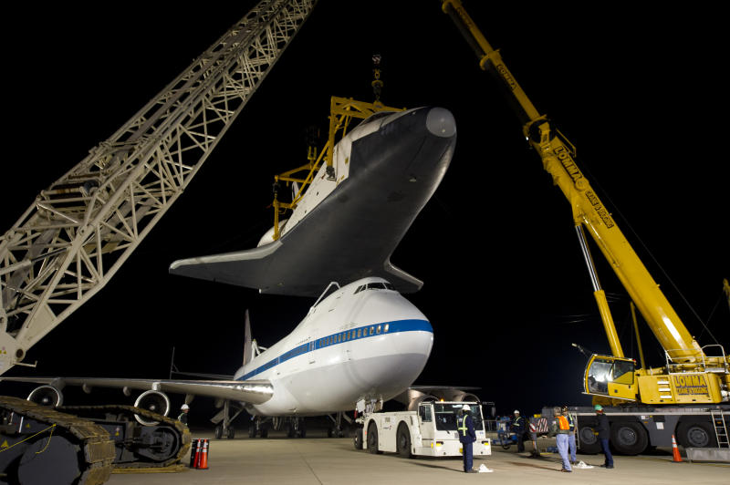 In this photo provided by NASA, the NASA 747 Shuttle Carrier Aircraft moves into place for mating underneath the space shuttle Enterprise for transport to New York at Washington Dulles International Airport, Friday, April 20, 2012, in Sterling, Va. Enterprise is expected to go on display at the Intrepid Sea Air and Space Museum in New York. (AP Photo/NASA, Bill Ingalls)