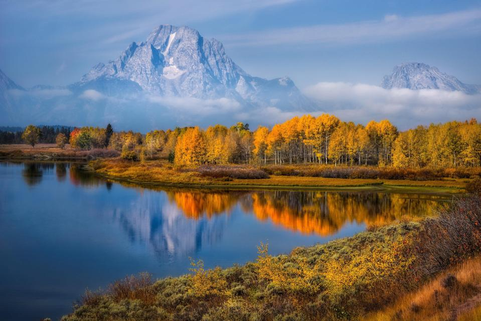 """On the roughly six-mile Taggart Lake and Bradley Lake Loop, you'll see a little bit of everything: the snow-capped peaks of the <a href=""""https://www.cntraveler.com/tag/grand-teton-national-park?mbid=synd_yahoo_rss"""" rel=""""nofollow noopener"""" target=""""_blank"""" data-ylk=""""slk:Grand Tetons"""" class=""""link rapid-noclick-resp"""">Grand Tetons</a> high above sagebrush flats; a rushing creek; two glacially-formed lakes; wide-open terrain; and, of course, bright yellow aspen. Keep your eyes peeled for moose, deer, and horses, too—they're allowed on the trail."""
