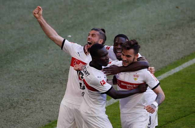 Soccer Football - Bundesliga - Bayern Munich v VfB Stuttgart - Allianz Arena, Munich, Germany - May 12, 2018 Stuttgart's Chadrac Akolo celebrates scoring their third goal with team mates REUTERS/Michaela Rehle DFL RULES TO LIMIT THE ONLINE USAGE DURING MATCH TIME TO 15 PICTURES PER GAME. IMAGE SEQUENCES TO SIMULATE VIDEO IS NOT ALLOWED AT ANY TIME. FOR FURTHER QUERIES PLEASE CONTACT DFL DIRECTLY AT + 49 69 650050