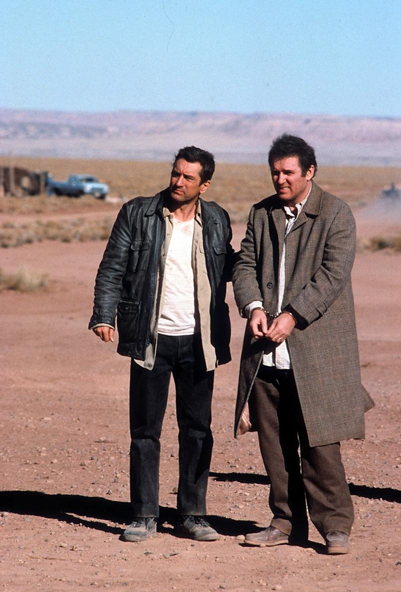 Robert De Niro stands in the desert with Charles Grodin in a scene from the film 'Midnight Run', 1988. (Photo by Universal/Getty Images)