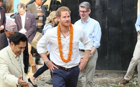Prince Harry being accompanied by Richard Morris during a visit to Nepal in 2016 - Credit: Danny Martindale