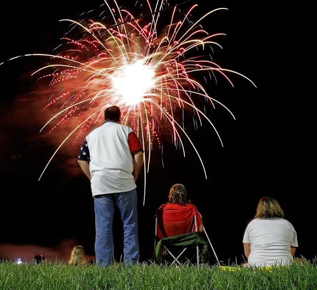 <p>People watch a fireworks display for Independence Day at Worlds of Fun amusement park Monday, July 3, 2017, in Kansas City, Mo. (Photo: Charlie Riedel/AP) </p>