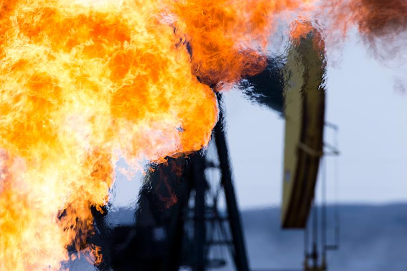 A methane gas flare and pump jack at an oil well in the Bakken Oil Fields, North Dakota. (Photo: Richard Hamilton Smith via Getty Images)