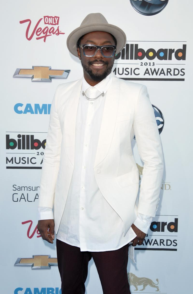 "FILE - In this May 19, 2013 photo, Will.i.am arrives at the Billboard Music Awards at the MGM Grand Garden Arena in Las Vegas. Will.i.am says his ""I AM"" trademark is too similar to one Pharrell's company tried to register. (Photo by John Shearer/Invision/AP, File)"