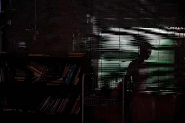 <p>A student is seen through blinds at a dormitory in Lirboyo Islamic boarding school in Kediri, Indonesia, May 18, 2018. (Photo: Beawiharta/Reuters) </p>