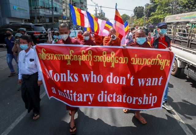 Buddhist monks march during a protest against the military coup in Yangon, Myanmar (AP Photo)