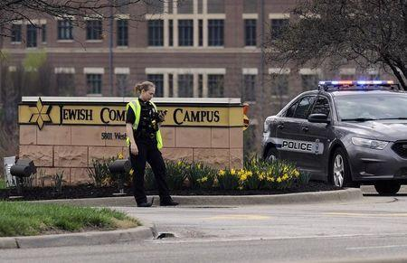 A police officer guards the entrance to the scene of a shooting at the Jewish Community Center of Greater Kansas City in Overland Park, Kansas