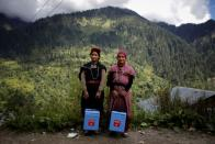 The Wider Image: Doctors scale rockslides, invoke gods to vaccinate Himalayan villages