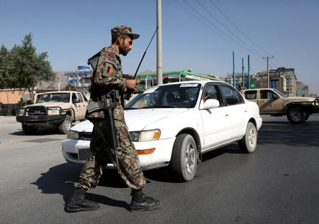 An Afghan National Army (ANA) soldier stands at a check point in Kabul, Afghanistan
