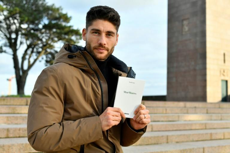 Brest midfielder Paul Lasne with his book