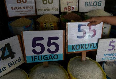 Prices of different variety of rice are seen in a public market in Kamuning in Quezon City, metro Manila, May 21, 2018. REUTERS/Dondi Tawatao