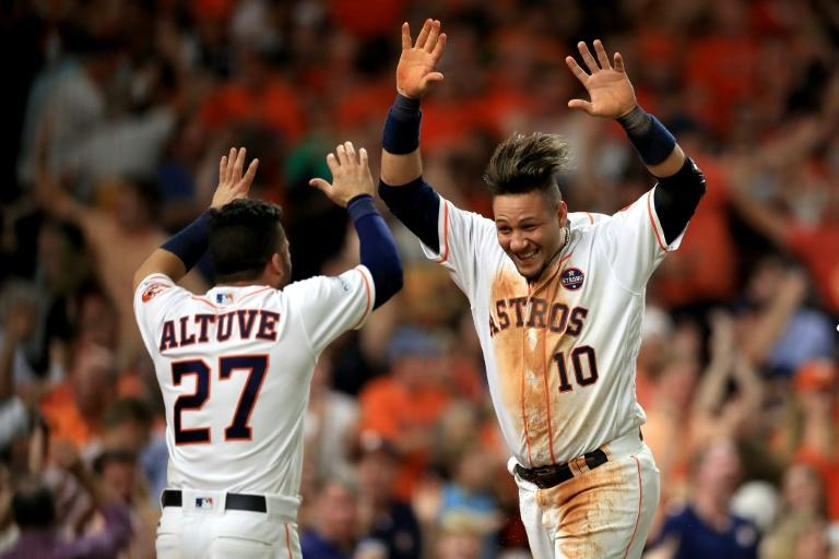 Yuli Gurriel #10 of the Houston Astros celebrates with teammate Jose Altuve #27 after scoring off of a double hit by Brian McCann #16 against Tommy Kahnle #48 of the New York Yankees