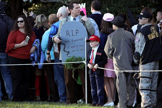 <p>Guests attend Halloween at the White House on the South Lawn Oct. 30, 2017 in Washington, D.C. President Donald Trump and first lady Melania Trump gave cookies away to costumed trick-or-treaters one day before the Halloween holiday. (Photo: Chip Somodevilla/Getty Images) </p>