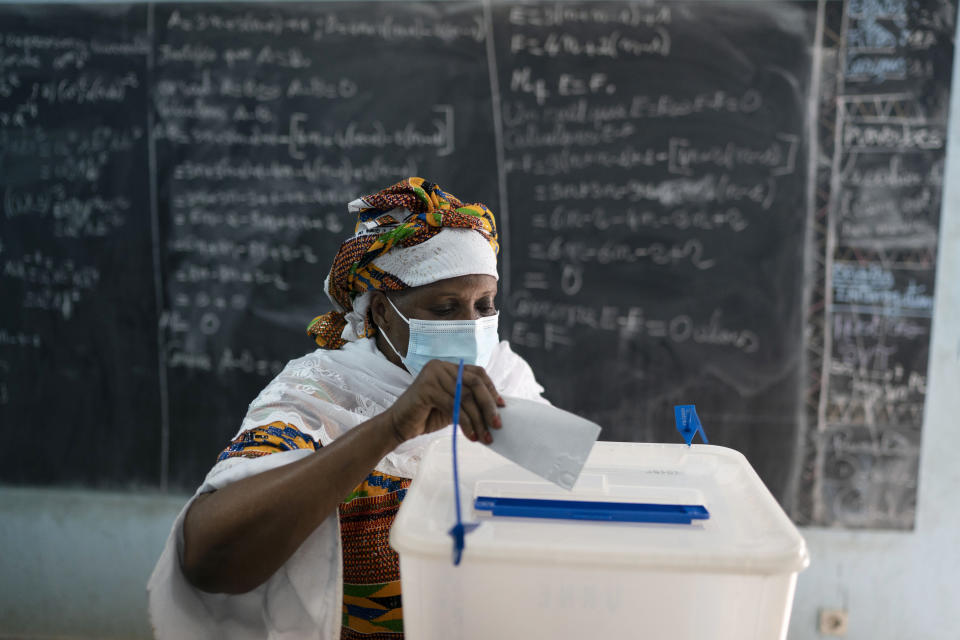 A woman casts her vote during presidential election in Abidjan, Ivory Coast, Saturday, Oct. 31, 2020. Tens of thousands of security forces deployed across Ivory Coast on Saturday as the leading opposition parties boycotted the election, calling President Alassane Ouattara's bid for a third term illegal. (AP Photo/Leo Correa)