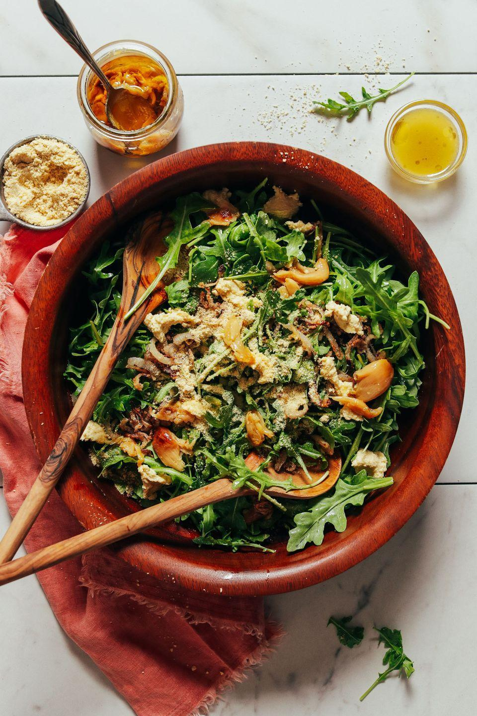 """<p>The crispy shallots in this salad remind us of the crunchy onions you often find on green bean casseroles. They're savory, salty, and sure to become a new favorite.</p><p><strong>Get the recipe at <a href=""""https://minimalistbaker.com/lemony-arugula-salad-with-crispy-shallot/"""" rel=""""nofollow noopener"""" target=""""_blank"""" data-ylk=""""slk:Minimalist Baker"""" class=""""link rapid-noclick-resp"""">Minimalist Baker</a>.</strong></p>"""