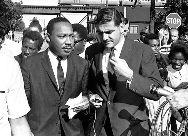 """<p>Reporters interview the Rev. Martin Luther King, Jr., after a circuit court issued an injunction restricting civil rights marches in Chicago, Aug. 20, 1966. King labeled the action """"unjust, illegal and unconstitutional."""" (AP Photo/Larry Stoddard) </p>"""
