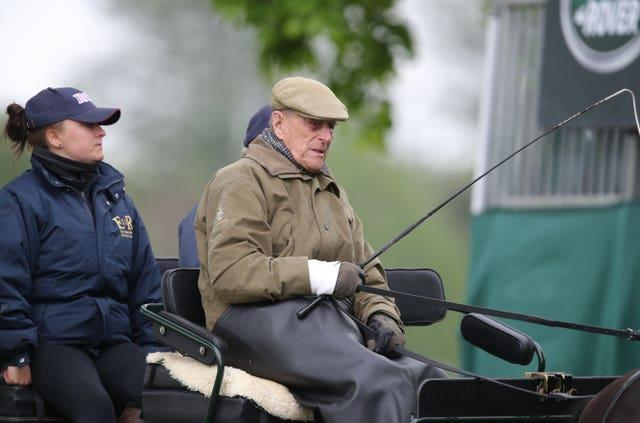 The Duke of Edinburgh drives a carriage (Andrew Matthews/PA)