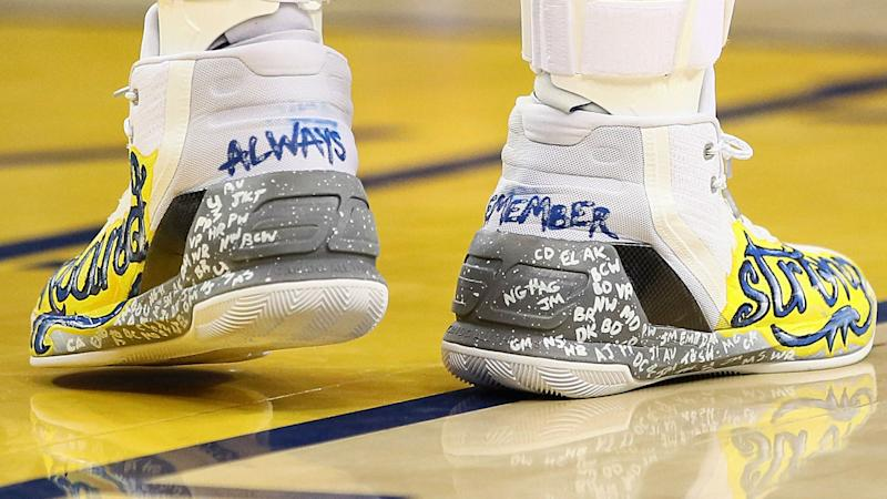 22954bb6bfec Stephen Curry s shoes honoring fire victims fetch  45K in auction
