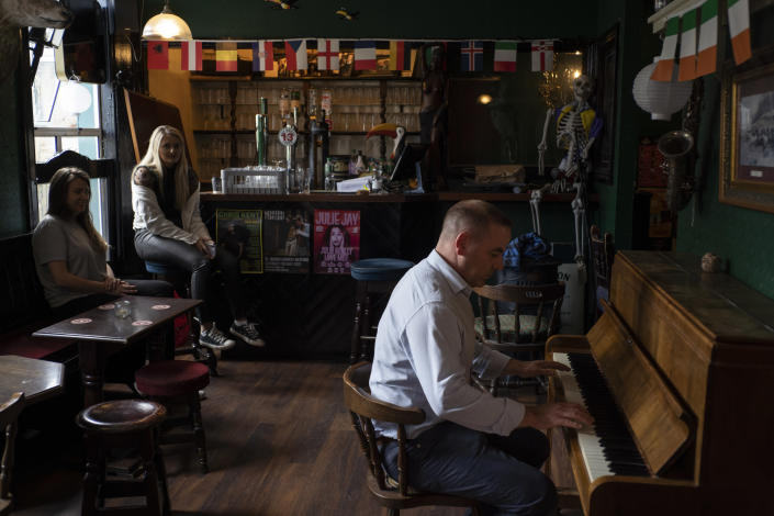 Brian Byrne, Director of Event Planning, who, thanks to a government program, keeps employees on pay during the coronavirus pandemic, plays the piano at a comedy club in Wexford Town, Ireland, July 1, 2020 (Paulo Nunes dos Santos / New York Times)