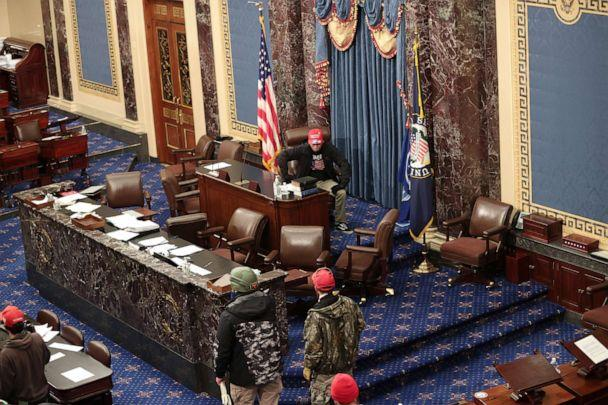 PHOTO: Trump supporters enter the Senate Chamber on Jan. 06, 2021, in Washington, D.C. (Win Mcnamee/Getty Images)
