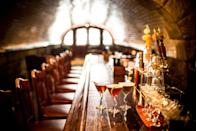 """<p><em>Northampton, MA</em></p><p>Enjoy a premium cocktail at Northampton's <a href=""""http://www.thetunnelbar.com"""" rel=""""nofollow noopener"""" target=""""_blank"""" data-ylk=""""slk:The Tunnel Bar"""" class=""""link rapid-noclick-resp"""">The Tunnel Bar</a>. The structure housing the bar was built in 1896, when trains were a primary mode of long-distance transportation. Now, it is an elegant and sophisticated lounge.</p><p>Photo: <a href=""""http://www.thetunnelbar.com"""" rel=""""nofollow noopener"""" target=""""_blank"""" data-ylk=""""slk:The Tunnel Bar"""" class=""""link rapid-noclick-resp"""">The Tunnel Bar</a></p>"""