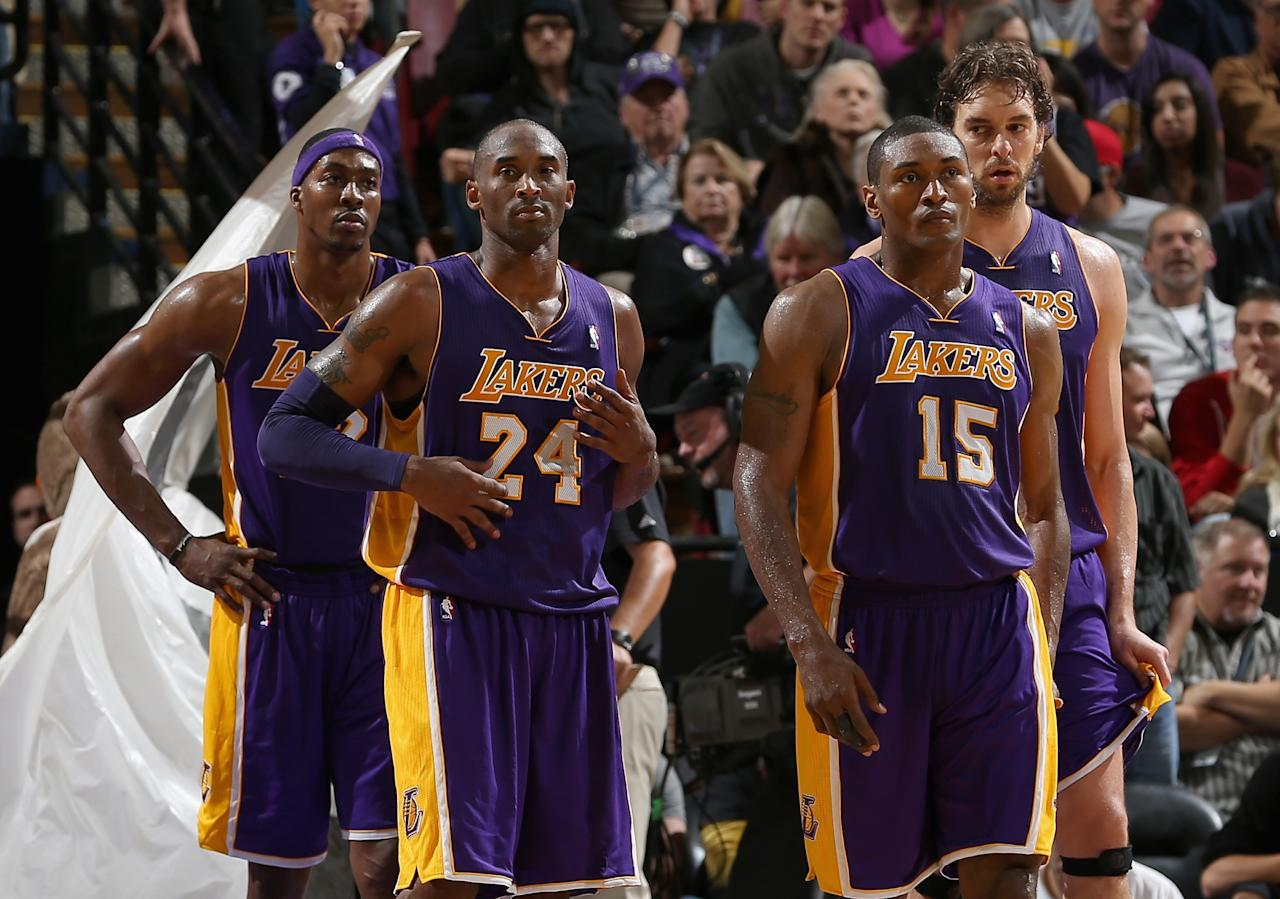 SACRAMENTO, CA - NOVEMBER 21:  Dwight Howard #12, Kobe Bryant #24, Metta World Peace #15, and Pau Gasol #16 of the Los Angeles Lakers stand together during a time out during their loss against the Sacramento Kings at Power Balance Pavilion on November 21, 2012 in Sacramento, California.  NOTE TO USER: User expressly acknowledges and agrees that, by downloading and or using this photograph, User is consenting to the terms and conditions of the Getty Images License Agreement.  (Photo by Ezra Shaw/Getty Images)