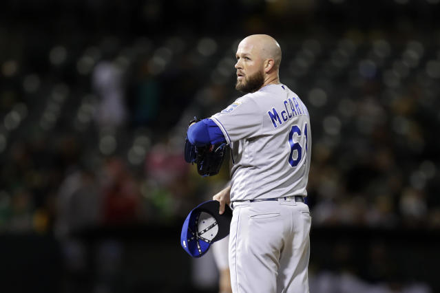 Kansas City Royals' Kevin McCarthy pauses in the eighth inning of a baseball game against the Oakland Athletics after giving up an RBI single to A's Khris Davis, Monday, Sept. 16, 2019, in Oakland, Calif. (AP Photo/Ben Margot)