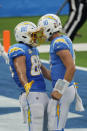 Los Angeles Chargers tight end Hunter Henry, left, celebrates his touchdown catch with Justin Herbert (10) during the first half of an NFL football game against the New York Jets Sunday, Nov. 22, 2020, in Inglewood, Calif. (AP Photo/Jae C. Hong)