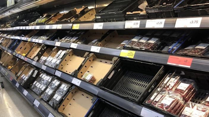 Many items were missing from the fresh food aisle at this Sainsbury's in Belfast on Monday