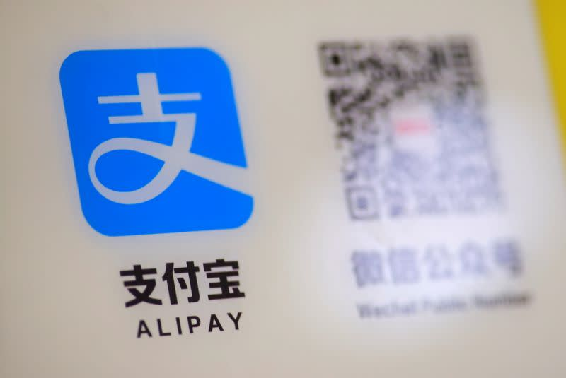 FILE PHOTO: A logo of the electronic payment service Alipay that belongs to Ant Group Co Ltd is seen at a vending machine in Beijing