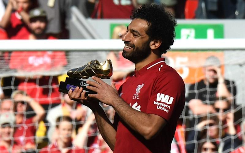 Mo Salah receives his Golden Boot award after Liverpool's win over Brighton - AFP