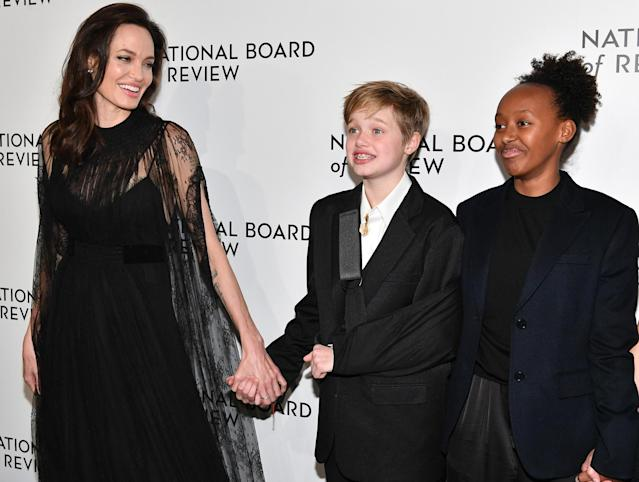 "<p>Angelina also brought Shiloh and Zahara to the National Board of Review Awards Gala on Jan. 9, where she accepted the Freedom of Expression Award for her film <em>First They Killed My Father. </em>Shiloh sported a sling after her <a href=""https://www.yahoo.com/lifestyle/angelina-jolie-apos-daughter-shiloh-134711903.html"" data-ylk=""slk:recent snowboarding accident;outcm:mb_qualified_link;_E:mb_qualified_link"" class=""link rapid-noclick-resp newsroom-embed-article"">recent snowboarding accident</a>. (Photo: Dia Dipasupil/FilmMagic) </p>"