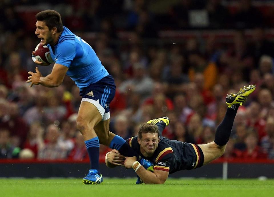 Italy's Giovanbattista Venditti (L) is tackled by Wales' Dan Biggar during the match ahead of the 2015 Rugby World Cup, at The Millennium Stadium in Cardiff, south Wales, on September 5, 2015 (AFP Photo/Geoff Caddick)