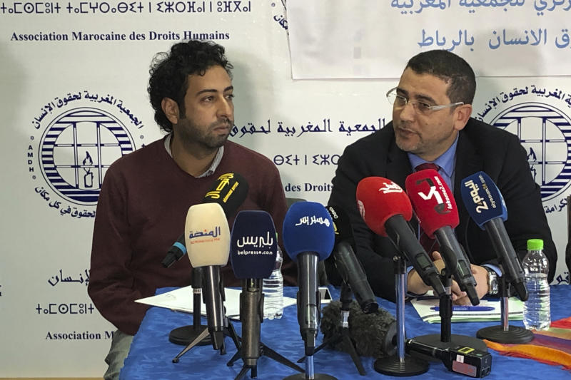 Omar Radi, left, and one of his lawyer Miloud Kandil attend a press conference at the Moroccan Association for Human Rights in Rabat, Thursday Jan 9 2020. Omar Radi is facing a trial for insulting a judge after publishing a tweet defending anti-government protesters. His next hearing will be on March 4. (AP Photo/Nadine Achoui-Lesage)