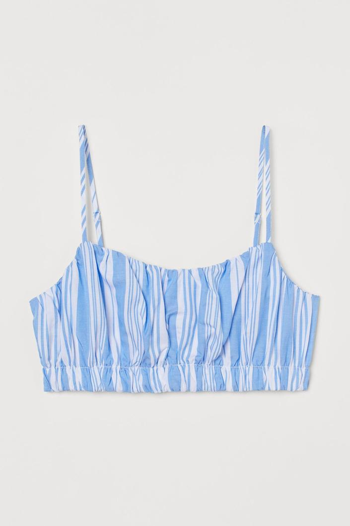 <p>This <span>Lyocell-blend Crop Top</span> ($18) will look cute with some jeans and a pair of low-heeled sandals.</p>
