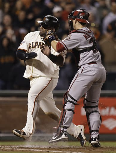 Arizona Diamondbacks catcher Miguel Montero, right, tags out San Francisco Giants' Pablo Sandoval at home plate in the tenth inning of a baseball game Tuesday, April 23, 2013, in San Francisco. (AP Photo/Ben Margot)