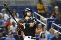 Miami Marlins' JT Riddle watches his three-run home run during the third inning of a baseball game against the New York Mets, Friday, June 29, 2018, in Miami. (AP Photo/Wilfredo Lee)