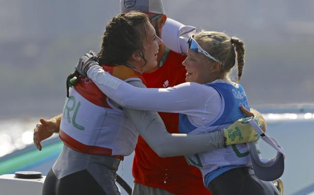 2016 Rio Olympics - Sailing - Final - Women's One Person Dinghy - Laser Radial - Medal Race - Marina de Gloria - Rio de Janeiro, Brazil - 16/08/2016. Bronze medalist Anne-Marie Rindom (DEN) of Denmark and silver medalist Annalise Murphy (IRL) of Ireland celebrate. REUTERS/Brian Snyder FOR EDITORIAL USE ONLY. NOT FOR SALE FOR MARKETING OR ADVERTISING CAMPAIGNS.