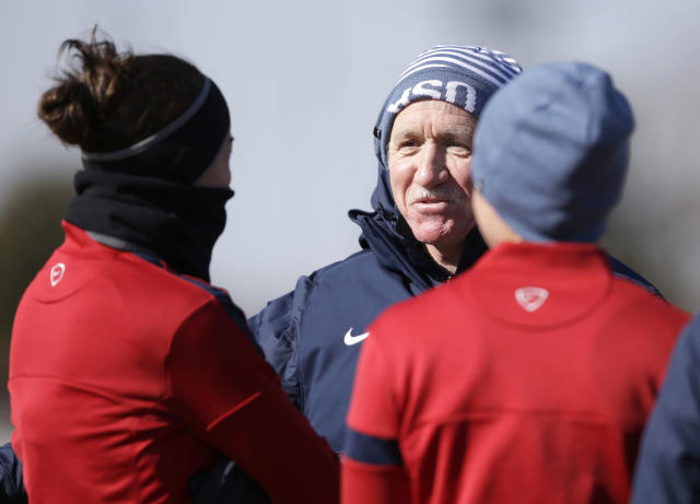 "In this photo taken on Tuesday, Jan. 28, 2014, U.S. women's soccer head coach Tom Sermanni speaks to players during team practice in Frisco, Texas. Sermanni found out what a unique job it is to be coach of the top-ranked U.S. women's soccer team. Now he's headed into his second year, one in which he is looking for performance and results into World Cup qualifying after a year of what he called ""assessment and opportunity.'' (AP Photo/LM Otero,Pool)"